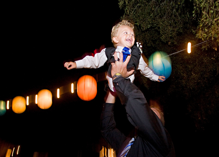 flying boy at wedding reception