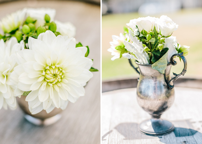 flower arrangements at rustic barn wedding