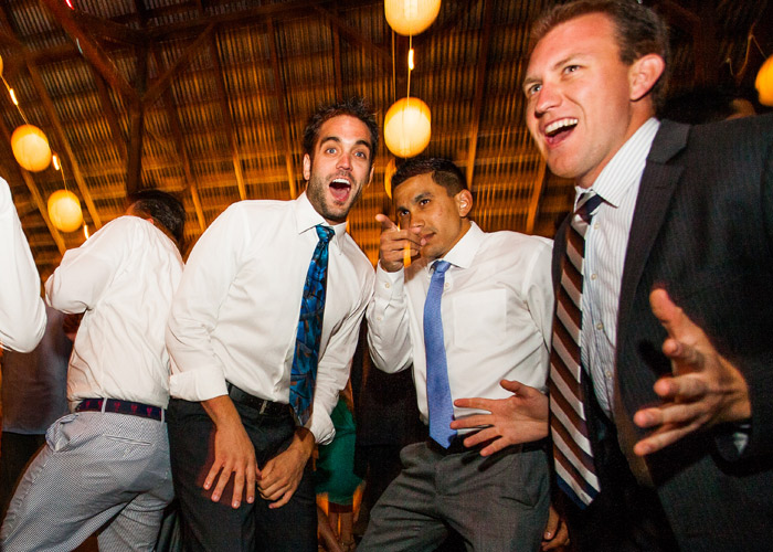 guys getting wild at wedding dance