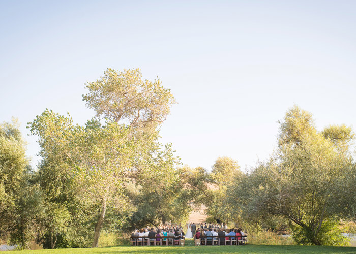 Ceremony by the pond at Greengate Ranch.