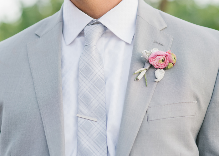 Groom with pink attire.