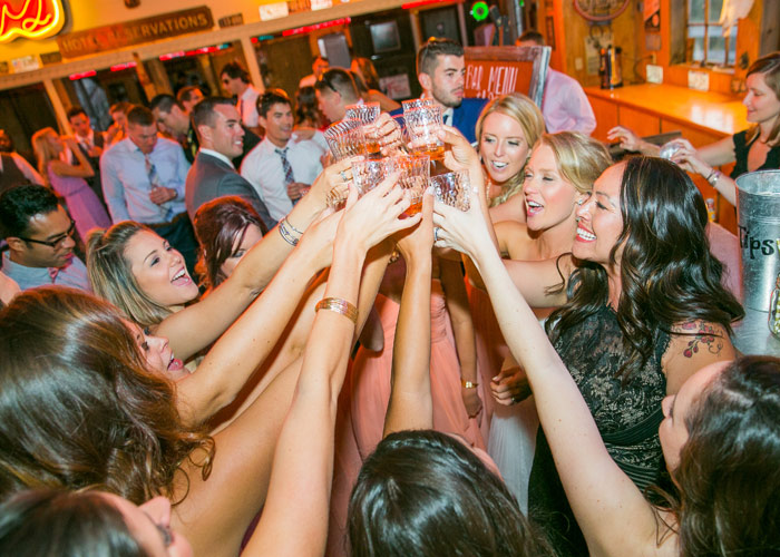 Bride and Bridesmaids toasting during reception.